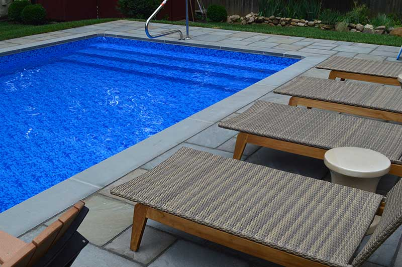 Rectangle Pool with Blue Stone Patio